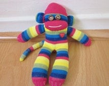 Miniature rainbow sock monkey plush - magenta, green, blue, and yellow stripes with red heart - mini sock monkey doll