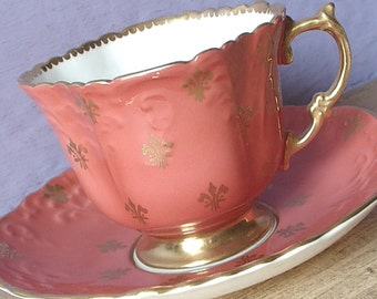 Antique Aynsley orange tea cup and saucer, bone china tea cup, English tea cup, orange and gold fleur de lis tea cup, antique tea cup