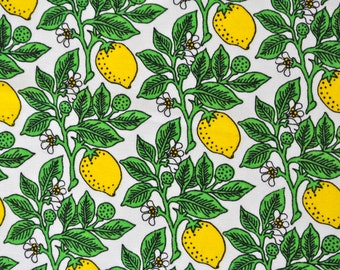 Vintage 1970s quilt fabric in highquality unused cotton with larger printed citrus/ leafe leafe pattern on white bottomcolor