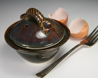 Egg poacher in brown glaze