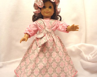 Five-piece outfit, for 18 inch dolls.  Blouse, Jumper, Pantaloons, Cap, and Purse.