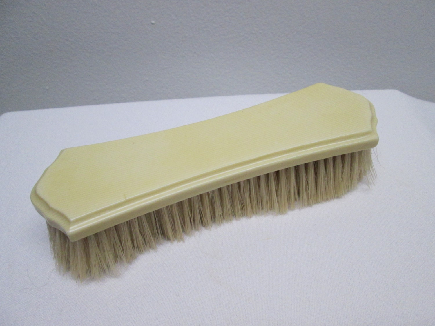 vintage clothing brush celluloid faux ivory by heyjunkman