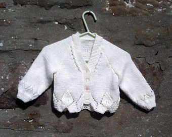 "Hand knitted baby girls cream cardigan with fancy edge. 16"" chest."