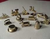 Lot of 11 Monopoly Gold Colored Game Pieces including Barrel and Thimble