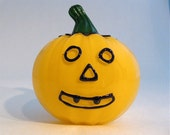 yellow/orange glass jack-o-lanern pumpkin
