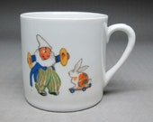 child's cup from germany with clown and rabbit etc