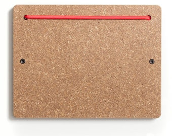 The Wheat Board Blokkey with a Red Bungee.  All in one organizer.