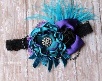 Over the top Rosette and Singed Satin Flower in Teal Aqua Purple and Black