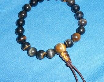 Hawks Eye Prayer bracelet / Wrist mala: Beautiful blue tigers eye 8mm beads with tigers eye guru beads.