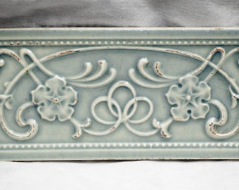 Powder blue swirly and floral tile