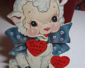 Very sweet 1940's die cut A-Meri-Card Valentine lamb wearing a big blue bow with hearts