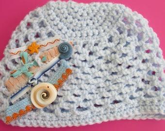 Newborn boy crochet beanie with shells and textiles