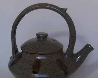 Large teapot. With celadon glaze and oxide spots. Stoneware, ceramics.