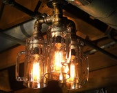 Ceiling light. Beer mugs and plumbing fittings. With vintage style Edison bulbs.