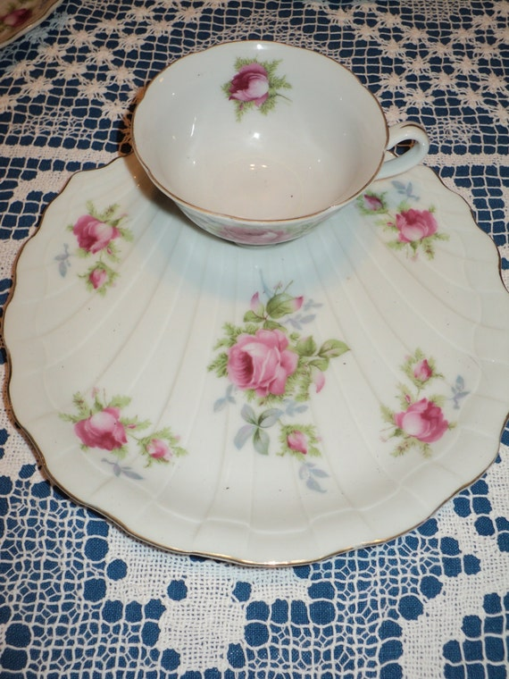 16 Vintage pieces of hand painted rose bud floral designs on fine bone china cups and buffet plates with scalloped edge finish