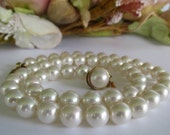 Vintage  pearl necklace by Majorica Spain with .925 silver clasp