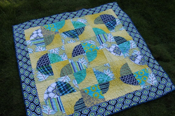 Playful Baby Quilt featuring Raw Edge Applique Circles in Blue, Turquoise, White and Acid Yellow