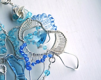 Wire Wrapped bracelet, three blue Roses