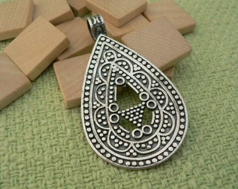 Turkish sterling silver oval pendant. 2 1/2 inches x 1 3/8 inches
