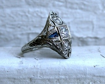 Vintage Fancy Filigree 18K White Gold Diamond and Sapphire Ring.