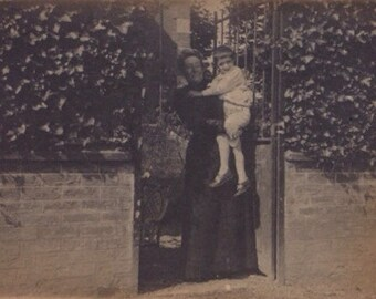 Original Antique Photograph Older Woman Holds Little Boy at Garden Ivy Covered Wall