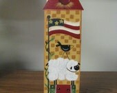A large clothespin, clip, recipe holder, picture holder, watermelon, sheep, flag, crow, saltbox house