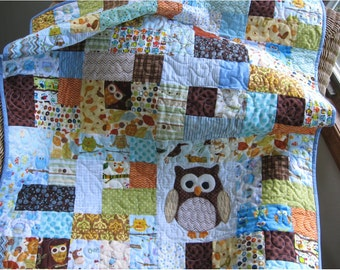 Custom Handmade owl quilt for a baby boys nursery, a scrappy owl quilt