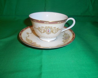One (1), Porcelain, Footed Tea Cup and Saucer, from Noritake, in the 1802 Pattern. Circa 1949.