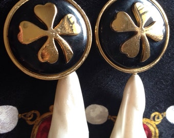 Vintage CHANEL white teardrop faux pearl earring with black and gold clover motif. Dangling earrings in large size