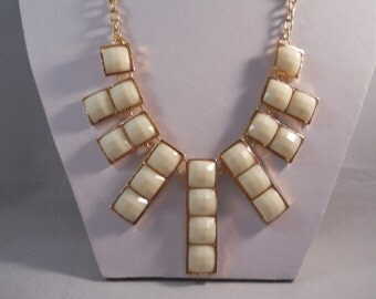 SALE Bib necklace with Gold Tone a Cream Color Pendent on a Gold T Chainone