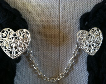 The mattie silver tone  filigree heart sweater clip adds a romantic touch to your cover ups.