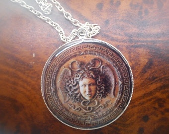 Medusa's head pendant. Gorgon.