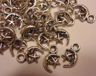 8 tibetan silver star and moon charms, 12 x 8 mm (9)