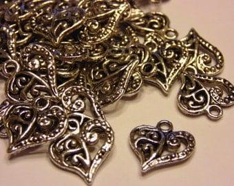 6 Tibetan silver fancy heart charms, 15 x 14 mm (8)
