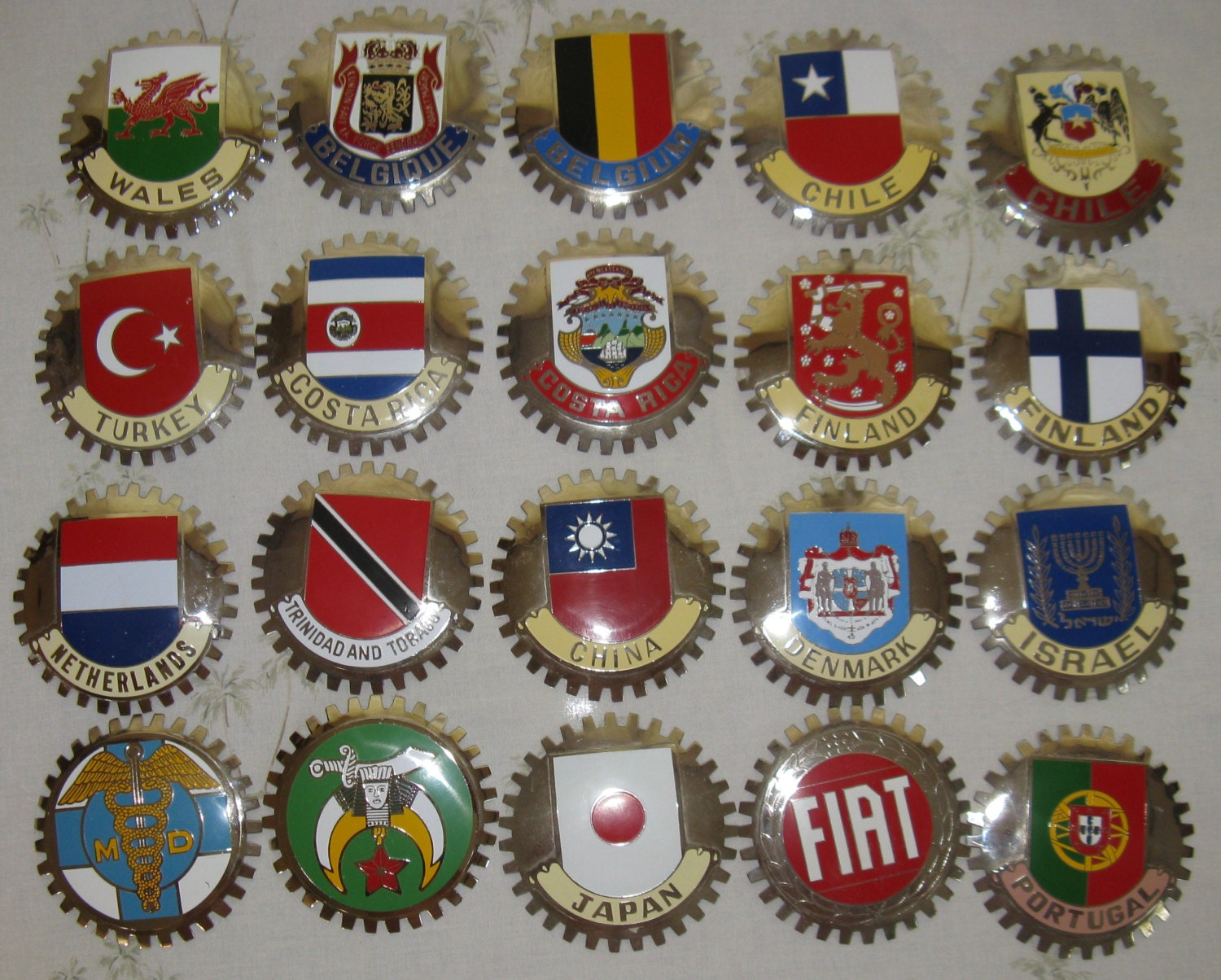 vintage car grill badges of countries cars shriners and md. Black Bedroom Furniture Sets. Home Design Ideas