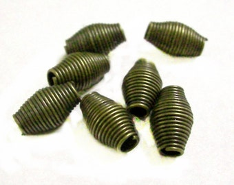 24pc 9x6mm antique bronze finish spring metal beads-9411