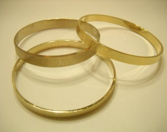 Three (3) Vintage Gold Tone Ridged Bangles (1543)