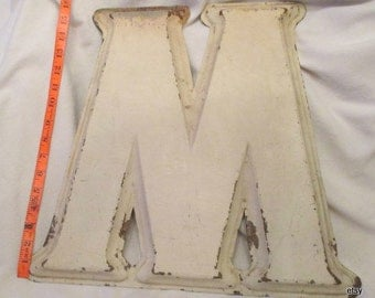 Sign, metal sign...M  or W ,  16  in. high by 17 in. wide,  1 in deep, ivory old paint or enameled, rust in some places