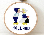 Funny cross stitch pattern of Delft Blue Holland boy kissing girl with Dutch Wooden Shoes and tulip. Engagement gift or wedding gift