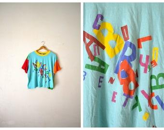 Vtg 90's Block Color Alphabet Shirt by Benetton