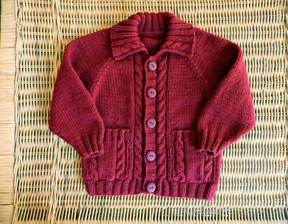 Hand knitted red baby cardigan with cables & pockets, fit 9-12 months
