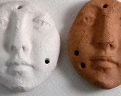 Two Unfinished Earthenware Shard Faces