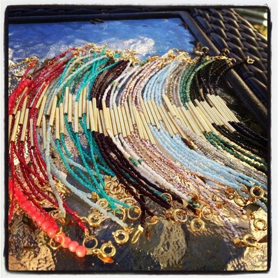 Tiny glass beads with gold tube bracelet