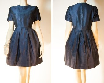 Gorgeous blue-black self patterned floral design part lined shiny nylon 1960's vintage back zip short sleeved full skirted dress - DB155