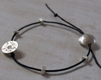 Stamped Textured Silver and Leather Bracelet..