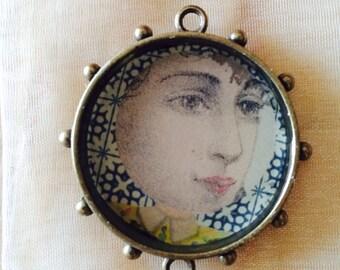 Woman's face pendant