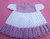 Hand knitted baby dress in white and mauve 0 - 3 months