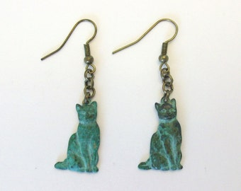 Cat earrings, Verdigris finish and antiqued bronze. Dangle earrings on French hook earring wires.