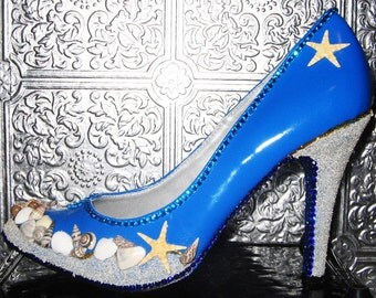 blue shoes with sand on heels and front, seashells, crystal rhinestones and glittered soles