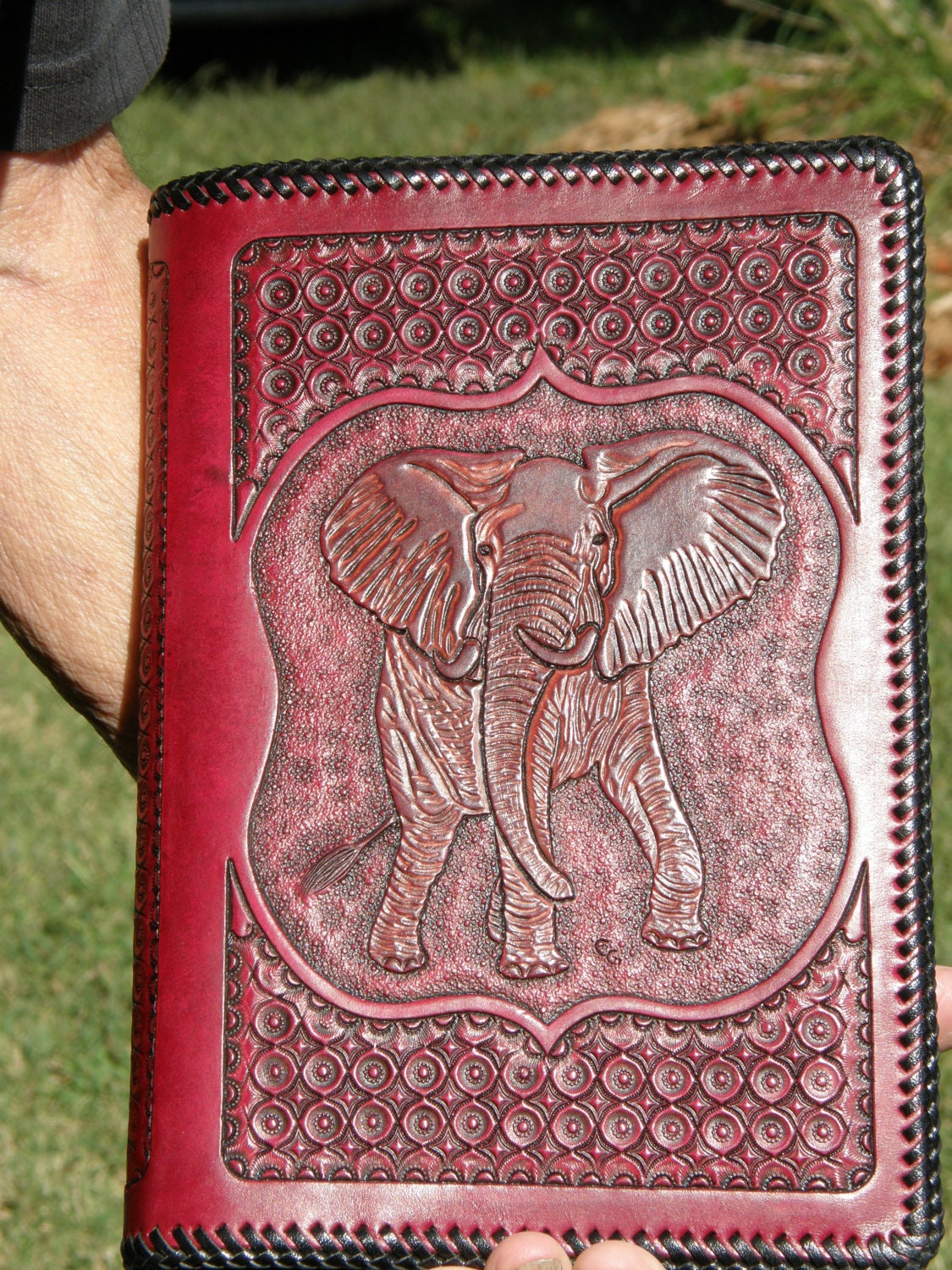 hand tooled leather bible or book cover by gardnersworkshop